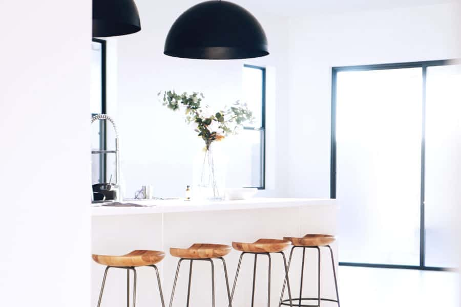 Simple kitchen with stools.