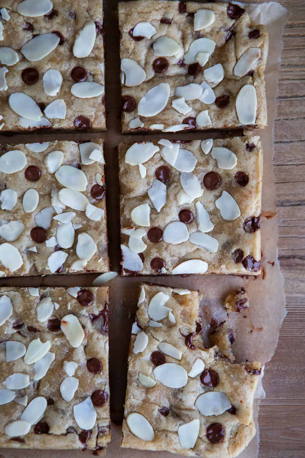 Flat-lay of blondies with chunk eaten